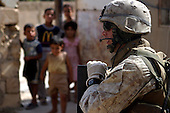 U.S. Marine Corps Lance Cpl. Mathew A. Calvert, from India Company, 3rd Battalion, 3rd Marine Regiment, provides security for fellow Marines searching a house in Haditha, Iraq, Aug. 7, 2006. (U.S. Marine Corps photo by Cpl. Brian M. Henner) (Released)