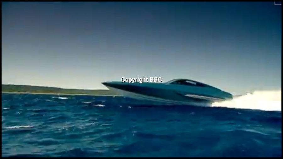 """BNPS.co.uk (01202) 558833<br /> Picture: BBC<br /> <br /> A luxury model was driven by TV presenter James May in a race against Richard Hammond's Ferrari Daytona from Portofino, Italy, to St Tropez, France in 2009.<br /> <br /> This James Bond-style powerboat made from Kevlar and carbon fibre was built to chase down pirates with its remote controlled machine gun and 100mph speeds. But now the cutting edge boat - the fastest military vessel ever made - is being sold with no reserve and is tipped to sell for a fraction of its £1.5 million value. It was dubbed """"the Bugatti Veyron of the seas"""" at it's launch, and Top Gear host Jeremy Clarkson called it """"the most beautiful thing ever created by man"""". But seven years on the 48ft superboat is among 300 lots including two other incomplete boats being sold off by manufacterers XSMG World to recover money owed to HM Revenue and Customs."""