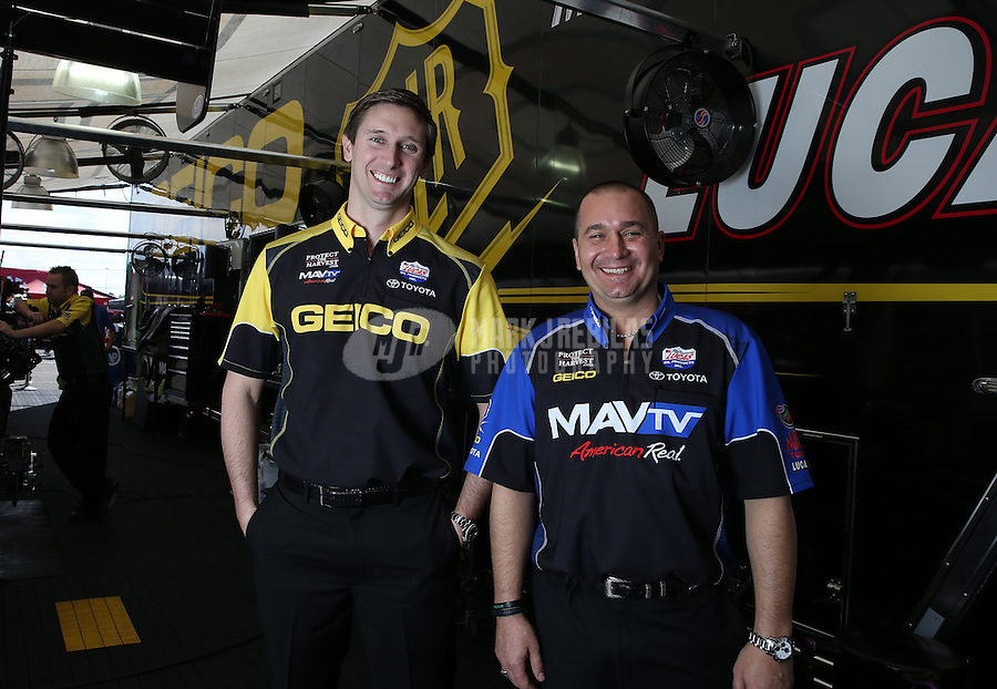 Feb. 16, 2013; Pomona, CA, USA; NHRA top fuel dragster driver Brandon Bernstein (right) and Morgan Lucas pose for a portrait during qualifying for the Winternationals at Auto Club Raceway at Pomona.. Mandatory Credit: Mark J. Rebilas-