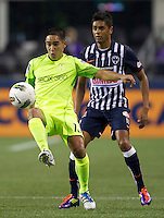 Seattle Sounders FC midfielder David Estrada, left, gets control of the ball in front of CF Monterrey forward Sergio Santana during a CONCACAF Champions League match at CenturyLink Field in Seattle Tuesday Oct. 18, 2011. CF Monterrey won the game 2-1.