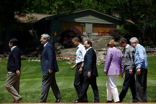 (L-R) Japanese Prime Minister Yoshihiko Noda, Canadian Prime Minister Stephen Harper,  U.S. President Barack Obama, French President Francois Hollande, German Chancellor Angela Merkel, British Prime Minister David Cameron, and Italian Prime Minister Mario Monti exit the stage after posing for a group photo during the 2012 G8 Summit at Camp David May 19, 2012 in Camp David, Maryland. Leaders of eight of the worlds largest economies meet over the weekend in an effort to keep the lingering European debt crisis from spinning out of control.  .Credit: Luke Sharrett / The New York Times / Pool via CNP