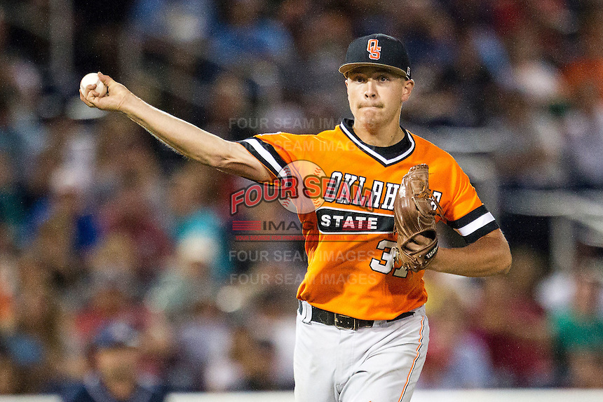 Oklahoma State Cowboys pitcher Tyler Buffett (37) makes a pickoff throw to first base against the Arizona Wildcats during Game 6 of the NCAA College World Series on June 20, 2016 at TD Ameritrade Park in Omaha, Nebraska. Oklahoma State defeated Arizona 1-0. (Andrew Woolley/Four Seam Images)