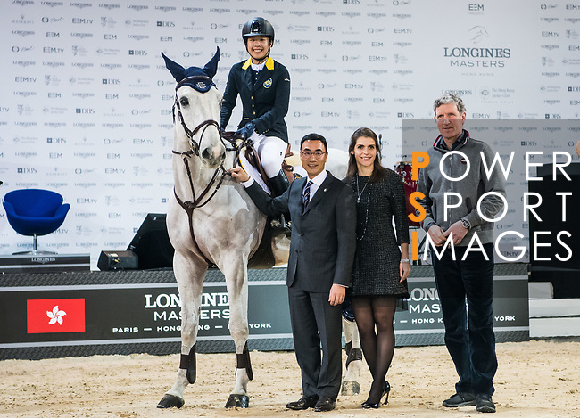 Michelle Li of Hong Kong riding Fiona DEcaussinnes poses for a photo with equestrian Ludger Beerbaum, Hong Kong Equestrian Federation President Michael Lee and at the JETS Challenge during the Longines Masters of Hong Kong at AsiaWorld-Expo on 10 February 2018, in Hong Kong, Hong Kong. Photo by Diego Gonzalez / Power Sport Images