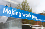 Making Work Pay banner in window of Jobcentre Plus office, Department for Work and Pensions, Devizes, Wiltshire, England, UK