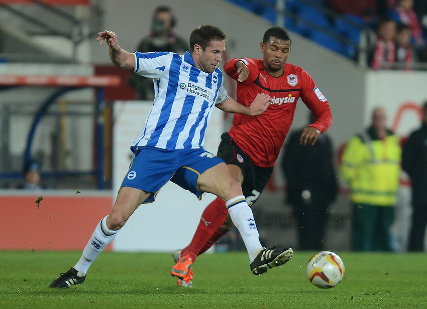 Brighton's Matthew Upson battles with Cardiff City's Fraizer Campbell .. - Credit - CameraSport - Ian Cook - ..Football - npower Football League Championship - Cardiff City v Brighton and Hove Albion - Tuesday 19th February 2013 - Cardiff City Stadium - Cardiff..© CameraSport - 43 Linden Ave. Countesthorpe. Leicester. England. LE8 5PG - Tel: +44 (0) 116 277 4147 - admin@camerasport.com - www.camerasport.com