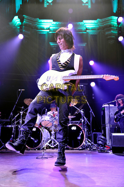 JEFF BECK.Performs live in concert at the Royal Albert Hall, London, England, UK, October 26th 2010..full length music onstage gig  guitar white  sleeveless shirt black waistcoat silver arm band leg foot .CAP/MAR.© Martin Harris/Capital Pictures.