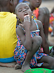 A girl enjoys lunch in the Loreto Primary School in Rumbek, South Sudan. The Loreto Sisters began a secondary school for girls in 2008, with students from throughout the country, but soon after added a primary in response to local community demands.