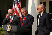 United States President George W. Bush announces his nomination of Henry M. Paulson, Jr. (right), Chairman and CEO of Goldman Sachs, to replace John W. Snow (left) as U.S. Treasury Secretary, in the Rose Garden of the White House in Washington, DC, May 30, 2006.<br /> Credit: Martin H. Simon - Pool via CNP