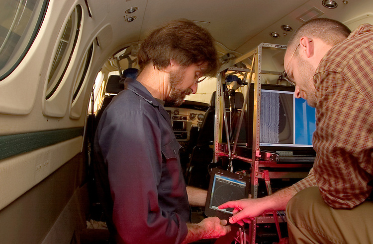 Jay Clark and an engineer working on inside King Air aircraft installation ...Jay Clark-  Avionics Engr Center.                    Chief Airborne Mobile Labs