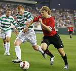 28 July 2004: Neil Lennon (center) and Jonathan Spector (right) challenge for the ball in the first half. Glasgow Celtic of the Scottish Premier League defeated Manchester United of the English Premier League 2-1 at Lincoln Financial Field in Philadelphia, PA in a ChampionsWorld Series friendly match..