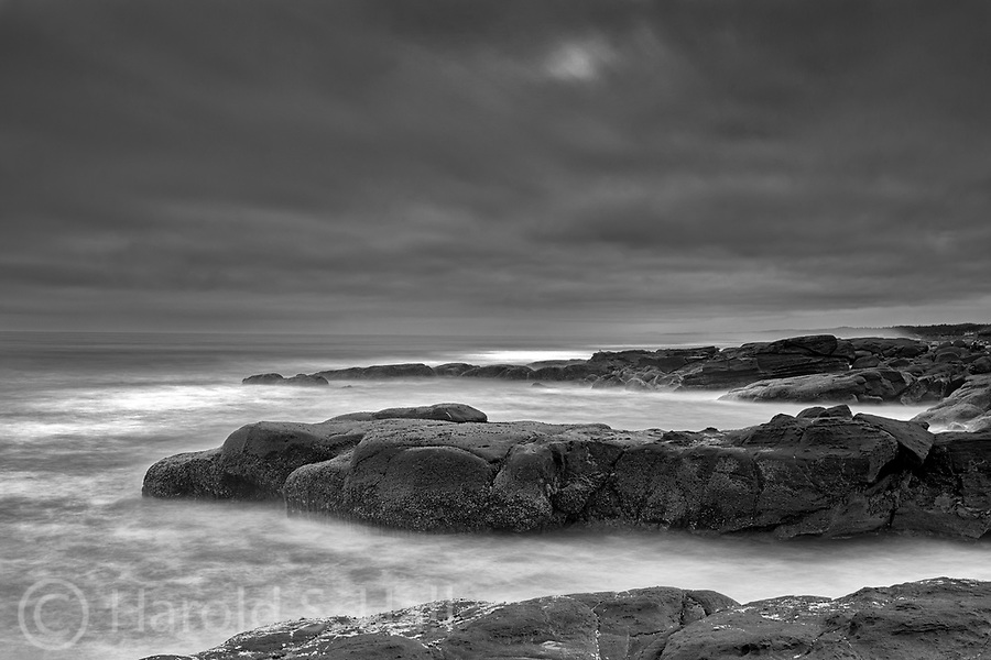 Light plays along the Yachats Oregon coastline on a stormy morning.