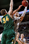 SIOUX FALLS, SD - MARCH 10: Cody Larson #34 from South Dakota State takes the ball to the basket against Chris Kading #34 from North Dakota State in the first half of the Summit League Championship Tournament game Tuesday at the Denny Sanford Premier Center in Sioux Falls, SD. (Photo by Dave EggenInertia)
