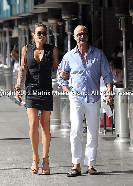 10 MARCH 2013 SYDNEY AUSTRALIA ..NON EXCLUSIVE ..Michelle Bridges pictured with her husband Bill Moore lunching at China Doll only days after announcing they has ended their marriage after nine years...*No internet without clearance*.MUST CALL PRIOR TO USE ..+61 2 9211-1088.Matrix Media Group.Note: All editorial images subject to the following: For editorial use only. Additional clearance required for commercial, wireless, internet or promotional use.Images may not be altered or modified. Matrix Media Group makes no representations or warranties regarding names, trademarks or logos appearing in the images.