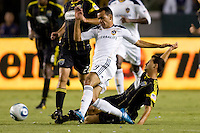 Columbus Crew midfielder Dilly Duka tackles LA Galaxy midfielder Juninho. The LA Galaxy defeated the Columbus Crew 3-1 at Home Depot Center stadium in Carson, California on Saturday Sept 11, 2010.