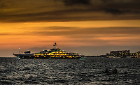 Fine Art Landscape Photograph of the Attessa IV anchored in Banderas Bay, Puerto Vallarta, Mexico. Awesome sunset photograph of the Attessa IV which is one of the largest private yachts in the world.