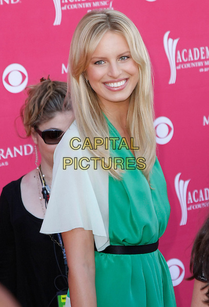 KAROLINA KURKOVA.The 43rd Annual Academy of Country Music Awards (ACM) held at MGM Grand Garden Arena, Las Vegas, Nevada, USA, .18 May 2008 .half length green dress white sleeves black waistband.CAP/ADM/MJT.©MJT/Admedia/Capital Pictures