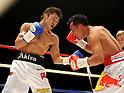 (L-R) Akira Yaegashi (JPN), Pornsawan Porpramook (THA), OCTOBER 24, 2011 - Boxing : Akira Yaegashi of Japan Pornsawan in action against Porpramook of Thailand during the fourth round of the WBA minimumweight title bout at Korakuen Hall in Tokyo, Japan. (Photo by Mikio Nakai/AFLO)