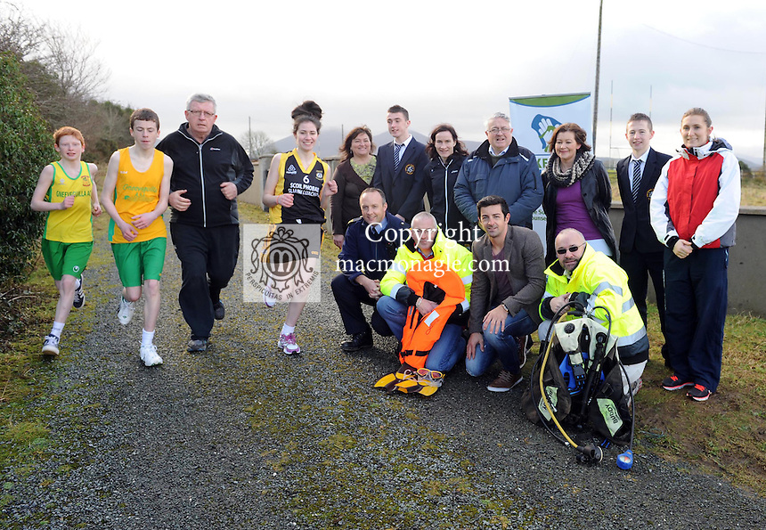 Former Kerry footballer and Operation Transformation leader Paudie O'Mahoney on the run with  Scoil Phobail Sliabh Luachra Rathmore  students  Anthony Darmody, Neil O'Riordan  Marie Anne Fleming at the launch of a charity Run/Walk that will take place in Rathmore on  Saturday March 1st. Looking on are  front from left, Garda John Crowley (Community Garda), John Shannon (Killarney Water Rescue ),  Kerry footballer Aidan O'Mahony and John O'Loughlin (Killarney Water Rescue).  Standing from left are  Nikki Wissell (Kerry LifeLine  at SouthWest Counselling Centre) DJ Murphy, Catherine Kiely, Tommy Joe O'Donoghue (Gneeveguilla Athletic Club), Bernie Walsh,  Tim Cronin and Connie Vaughan.  Picture: Eamonn Keogh ( MacMonagle, Killarney)