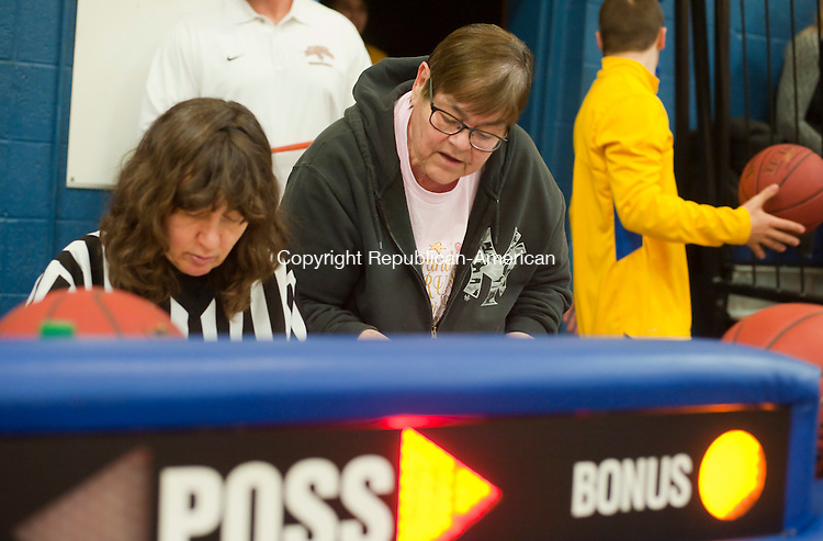 WINSTED, CT--- -011516JS09--Long time score keepers Gilbert's Cindy Fixer, left, and Northwestern's Shirley Gaura, right, go over their scoring books following the girls basketball game Friday at the Gilbert School in Winsted. <br />  Jim Shannon Republican-American