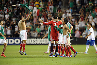 Mexico players celebrate at the end of the game... Mexico defeated Honduras 2-1 after extra time to win the CONCACAF Olympic qualifying trophy at LIVESTRONG Sporting Park, Kansas City, Kansas.