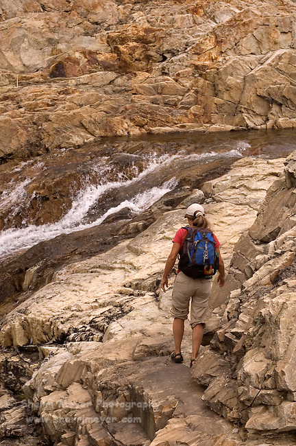 Woman hiking along Canyon Creek, Tahoe National Forest California
