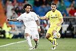 Real Madrid's Marcelo Vieira (l) and Villareal's Mario Gaspar during La Liga match. April 20,2016. (ALTERPHOTOS/Acero)