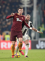Calcio, Serie A: Juventus vs Roma. Torino, Juventus Stadium,17 dicembre 2016. <br /> Roma's Edin Dzeko, left, is challenged by Juventus' Stefano Sturaro during the Italian Serie A football match between Juventus and Roma at Turin's Juventus Stadium, 17 December 2016.<br /> UPDATE IMAGES PRESS/Isabella Bonotto