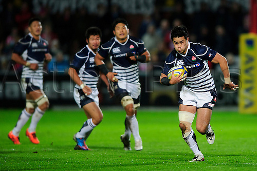 12.11.2013 Gloucester, England. Japan Fly-Half (#10) Yu Tamura breaks during the first half of the International Friendly Rugby Union match between Gloucester Rugby and Japan at Kingsholm Stadium.