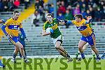 Ger Hartnette Kerry pulls away from Sean collins Clare in the McGrath cup at Fitzgerald Stadium on Sunday