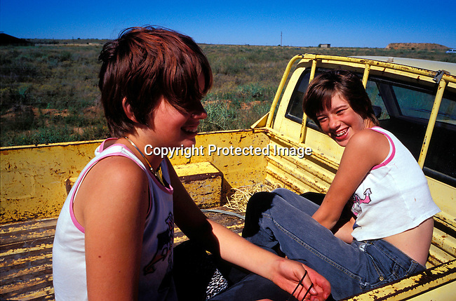 DIPOAFR00063.Culture Afrikaners Twin girls on a pick-up truck in Orania, an all white Afrikaner community farm in Northern Cape, South Africa..Photo: Per-Anders Pettersson/ iAfrika Photos