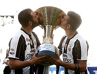 Calcio, Serie A: Juventus vs Crotone. Torino, Juventus Stadium, 21 maggio 2017.<br /> Juventus&rsquo; Gonzalo Higuain, left, and Paulo Dybala kiss the trophy during the celebrations for the victory of the sixth consecutive Scudetto at the end of the Italian Serie A football match between Juventus and Crotone at Turin's Juventus Stadium, 21 May 2017. Juventus defeated Crotone 3-0.<br /> UPDATE IMAGES PRESS/Isabella Bonotto
