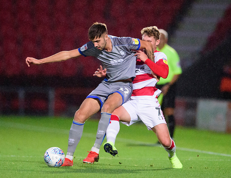 Lincoln City's Ellis Chapman battles with Doncaster Rovers' Kieran Sadlier<br /> <br /> Photographer Andrew Vaughan/CameraSport<br /> <br /> EFL Leasing.com Trophy - Northern Section - Group H - Doncaster Rovers v Lincoln City - Tuesday 3rd September 2019 - Keepmoat Stadium - Doncaster<br />  <br /> World Copyright © 2018 CameraSport. All rights reserved. 43 Linden Ave. Countesthorpe. Leicester. England. LE8 5PG - Tel: +44 (0) 116 277 4147 - admin@camerasport.com - www.camerasport.com