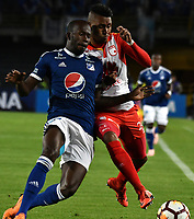 BOGOTÁ - COLOMBIA, 02-09-2018: Anier Figueroa (Izq.) jugador de Millonarios (COL), disputa el balón con Arley Rodríguez (Der.) jugador de Independiente Santa Fe (COL), durante partido de vuelta entre Millonarios (COL) y el Independiente Santa Fe (COL), de los octavos de final, llave A por la Copa Conmebol Sudamericana 2018, en el estadio Nemesio Camacho El Campin, de la ciudad de Bogotá. / Anier Figueroa (L) player of Millonarios (COL), fights for the ball with Arley Rodriguez (R) player of Independiente Santa Fe (COL), during a match of the second leg between Millonarios (COL) and Independiente Santa Fe (COL), of the eighth finals, key A for the Conmebol Sudamericana Cup 2018 in the Nemesio Camacho El Campin stadium in Bogota city. Photo: VizzorImage / Luis Ramírez / Staff.