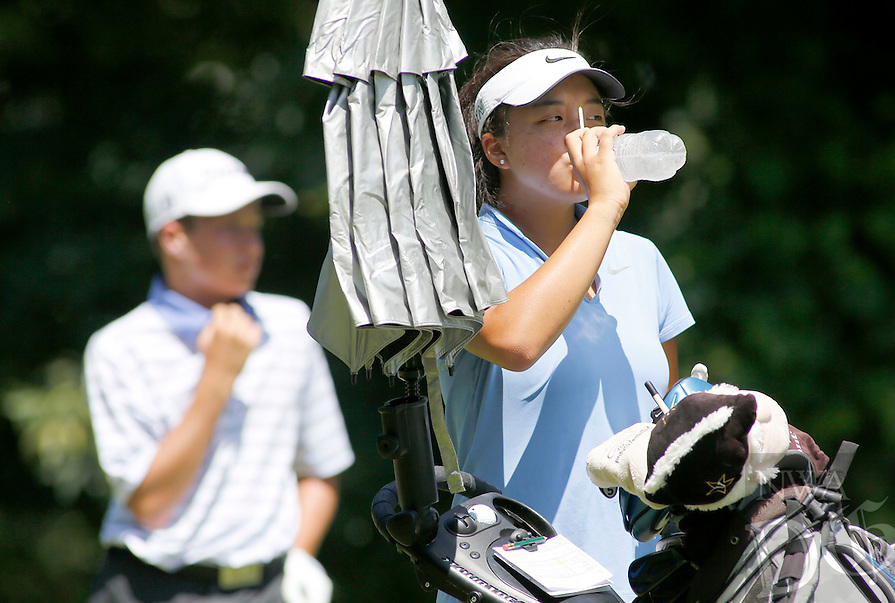 NWA Democrat-Gazette/DAVID GOTTSCHALK   Jayna Choi, from Collierville, Tenn., has a drink of water before her tee shot on the first hole Wednesday, June 22, 2016, on the second day of play during the Stacy Lewis All-Star Invitational junior golf tournament at The Blessings in Johnson.