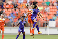 Houston, TX - Saturday June 17, 2017: Morgan Brian heads the ball away from Marta Vieira Da Silva during a regular season National Women's Soccer League (NWSL) match between the Houston Dash and the Orlando Pride at BBVA Compass Stadium.