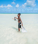 boy fishing in lagoon at Biketawa, Tarawa, Kiribati