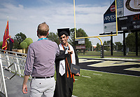 Graduate Nathan Sampara (center) elbow bumps Nathan Sampara Joshua Vest, administrator for Gateway and virtual school, Friday, July 17, 2020 during a graduation ceremony at Bentonville High School in Bentonville. Check out nwaonline.com/200718Daily/ for today's photo gallery. <br /> (NWA Democrat-Gazette/Charlie Kaijo)