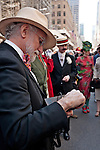 A photographer takes photos with a pin hole camera, of people wearing vintage clothing in the Easter Parade on Fifth Avenue in New York City