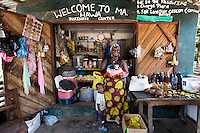 BRAC micro-finance project.. Hawa Edwards with Ruth Bawyeswon (customer)), small vendor . Got BRAc loan, makes about $100 per month.
