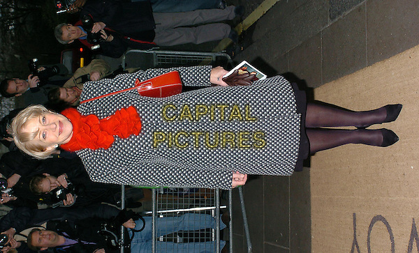 DAME HELEN MIRREN.South Bank Show Awards at the Savoy Hotel.23 January 2004.full length, full-length, coat, red scarf, handbag.www.capitalpictures.com.sales@capitalpictures.com.©Capital Pictures