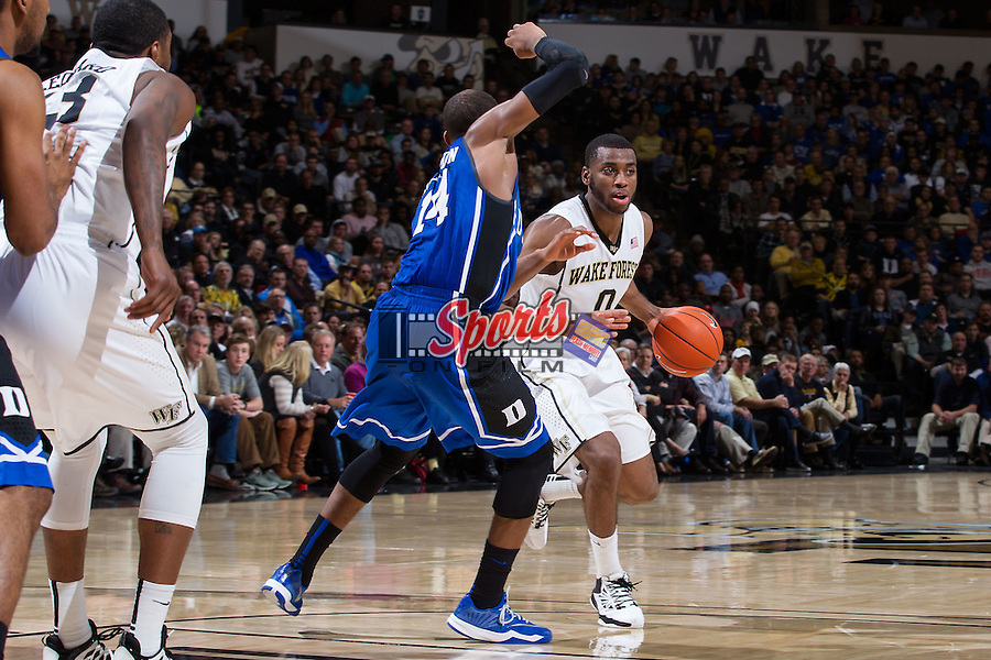 Codi Miller-McIntyre (0) of the Wake Forest Demon Deacons is guarded by Rasheed Sulaimon (14) of the Duke Blue Devils during second half action at the LJVM Coliseum on January 7, 2015 in Winston-Salem, North Carolina.  The Blue Devils defeated the Demon Deacons 73-65.  (Brian Westerholt/Sports On Film)