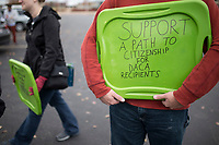 NWA Democrat-Gazette/CHARLIE KAIJO Andrew Kesl of Bentonville holds a sign on Friday, November 10, 2017 during a rally and three mile march that started at Rogers High School in Rogers. Marchers met to express support for the Dream Act and TPS (Temporary Protective Status). The march in Rogers is the third of a four-city tour for supporters of Dreamers. The final march will be in Bentonville in December, mostly likely before Congress goes into recess, said Andrea Garcia, a spokesman for the group.