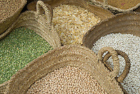 Dry beans and pulses for sale in baskets at the market in Fez, Morocco.