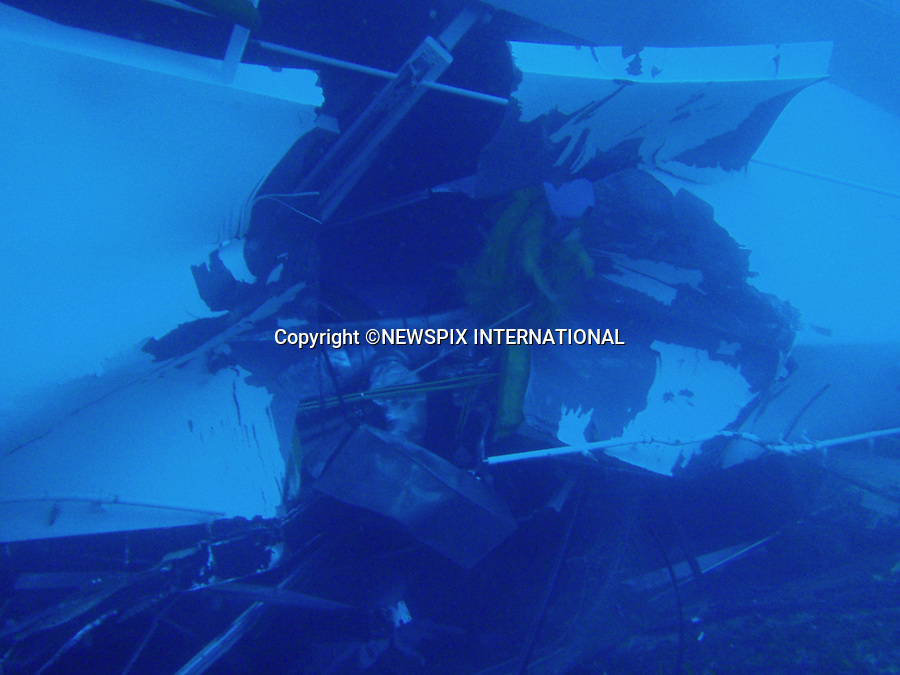 """Isola del Giglio, Italy_15/01/2012:  COSTA CONCORDIA RUNS AGROUND.The damage to the Costa Concordia that ran aground near Isola del Giglio, Italy, can be seen in these underwater photographs..The Costa Concordia, which was carrying more than 4,000 passengers, experienced trouble a few hundred metres from the tiny Tuscan holiday island of Giglio on Friday evening as the passengers were at dinner, after apparently sailing off course.Desperate passengers scrambled to evacuate the stricken vessel as it began to take on water and list to the right, with some opting to jump into the sea..A massive coastguard rescue operation involving helicopters and rescue boats was immediately launched.At daybreak, the ship could be seen almost completely on its side..Mandatory Credit Photo: ©Guardia di Finanza/NEWSPIX INTERNATIONAL..**ALL FEES PAYABLE TO: """"NEWSPIX INTERNATIONAL""""**..IMMEDIATE CONFIRMATION OF USAGE REQUIRED:.Newspix International, 31 Chinnery Hill, Bishop's Stortford, ENGLAND CM23 3PS.Tel:+441279 324672  ; Fax: +441279656877.Mobile:  07775681153.e-mail: info@newspixinternational.co.uk"""