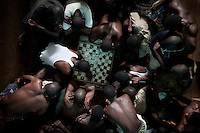 Inmates at Pademba Central Prison play a game of draughts.