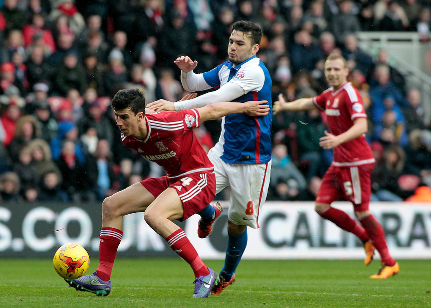 Middlesbrough's Daniel Ayala shields the ball from Blackburn Rovers' Tony Watt<br /> <br /> Photographer David Shipman/CameraSport<br /> <br /> Football - The Football League Sky Bet Championship - Middlesbrough v Blackburn Rovers - Saturday 6th February 2016 - Riverside Stadium - Middlesbrough <br /> <br /> &copy; CameraSport - 43 Linden Ave. Countesthorpe. Leicester. England. LE8 5PG - Tel: +44 (0) 116 277 4147 - admin@camerasport.com - www.camerasport.com