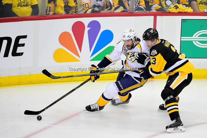 June 8, 2017: Pittsburgh Penguins defenseman Olli Maatta (3) battles with Nashville Predators center Craig Smith (15) through the corner during game five of the National Hockey League Stanley Cup Finals between the Nashville Predators  and the Pittsburgh Penguins, held at PPG Paints Arena, in Pittsburgh, PA. Eric Canha/CSM