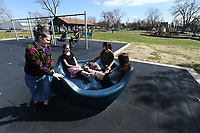 NWA Democrat-Gazette/J.T. WAMPLER Herlinda Lopez (LEFT) of Springdale pushes her daughters EsmŽe Lopez (RIGHT) and Ruby Lopez and their friend Abigail Goff (SECOND FROM LEFT) Monday March 19, 2018 at Luther George Park in Springdale. The park, located near downtown, features pavilions, exercise equipment, playgrounds, a skate park and open grass areas.
