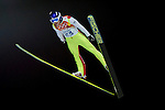 Mikhail Maksimochkin of Russia during the Men's Normal Hill Individual of the 2014 Sochi Olympic Winter Games at Russki Gorki Ski Juming Center on February 9, 2014 in Sochi, Russia. Photo by Victor Fraile / Power Sport Images