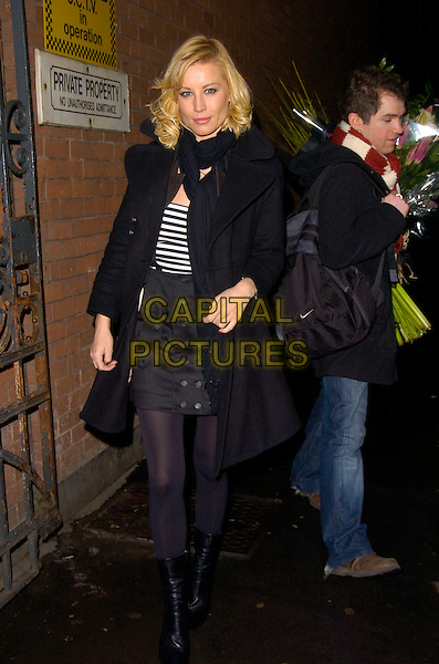 "DENISE VAN OUTEN.Denise Van Outen's final ""Rent"" performance, Duke of York Theatre, London, England..December 22nd, 2007.full length black coat jacket scarf boots striped stripes top buttons.CAP/CAN.©Can Nguyen/Capital Pictures"